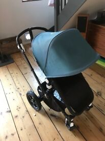 Black frame Bugaboo Cameleon 3 petrol material(hood and cot cover) comes with rain cover