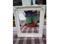 White carved mirror
