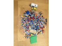 3 used Lego sets in plastic Lego storage box- (APPROX 1040 pieces)