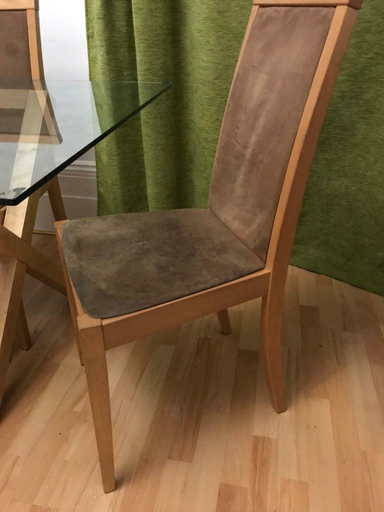 Table with 6 suede and wood chairs
