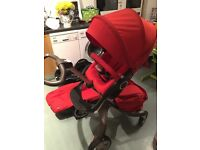 Stokke Xplory with Carrycot, carseat and carseat adapters. Red
