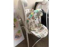 High chair and Graco baby swing.