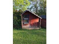Wooden kids playhouse with upstairs. Needs some work