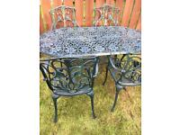 Beautiful ornate cast aluminium table and four marching chairs garden set