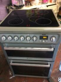 Silver Hotpoint 60cm ceramic hub electric cooker grill & double ovens good condition with guarantee
