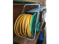 Hose on reel - can be fixed to the wall or freestanding. Very good condition.