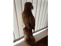 Bird of prey (red kite?) carved with chainsaw