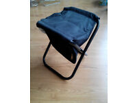 Foldable chair with bag inside
