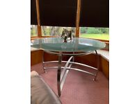 Glass metal dining table and 6 leather black chairs open to offers