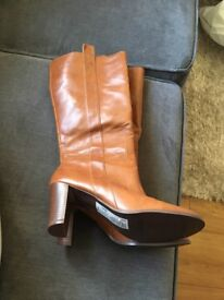 Brand new Women's high boots size 5 tan.