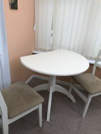 Table with four chairs immaculate white wood cloth seats on chairs suit kitchen or dining room