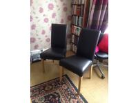 Two leather Effect Mid Back Chairs Good used condition bargain.