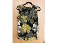 Black top with yellow and white pattern