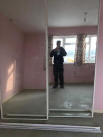 2 sliding mirrored doors