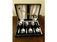 Boxed set of silver plated soup spoons