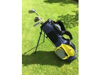 Junior left handed Dunlop golf clubs and bag