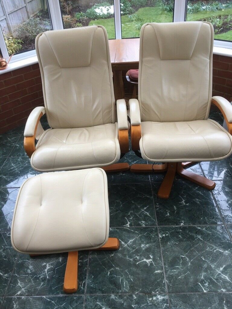 Pair of comfy Leather semi-reclining swivel chairs with built in Massage controls & 2 footstools
