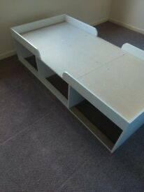 Ikea wooden single bed in white. Underbed storage and cupboard. 38 x 77 inches.