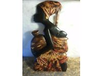 Original Awaakan wood hand crafted woman and child