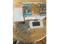 Wii U 8GB (Boxed) with 3 games.