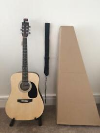 Acoustic guitar with strap and tuner in new condition