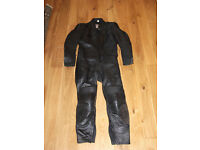 One piece black motorcycle leathers. Size 44