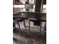 glass top chrome/leather table with 6 chairs