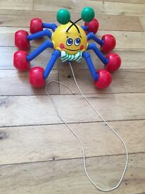 Pull along spider
