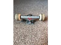 Pair of venture skateboard trucks with wheels and bolts