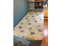 Single bed with extra mattress underneath