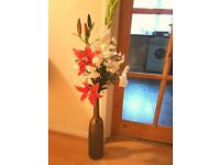 Tall dark brown vase with flowers