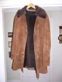 A Beautiful Leather/Suede coat with zip out inner and detachable collar.