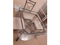 Heavy metal framed dining /garden table and four chairs