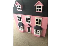 Pink wooden dolls house in excellent condition with some furniture included