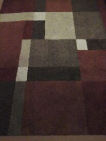 Tufted modern block coloured rug,in red , rust, cream , fawn and brown