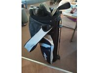 Selection of golf clubs and bags