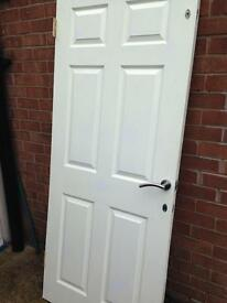 solid wood heavy duty 6 panel door with hinges, handles and 3 deadbolts.