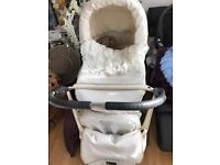 white leather pram and buggy