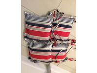 Four striped seat cushions