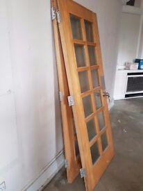 2x Solid Hardwood doors. Former bank security doors. 1 with lock intact & keys. Glass has spy glass.