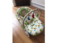 Baby Bouncer with vibration and place to hang toys