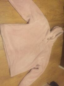 Pink fluffy Women's hoody from Urban Outfitters. Size small however is oversized.
