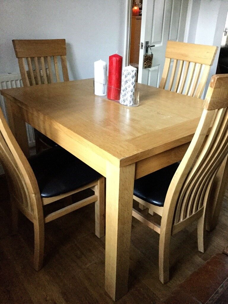 Beautiful Solid Wood Extendable Dining Table With Four Faux Leather
