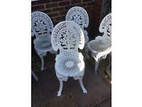Four White Wrought Iron Chairs.