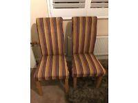 High backed oak framed pair of chairs