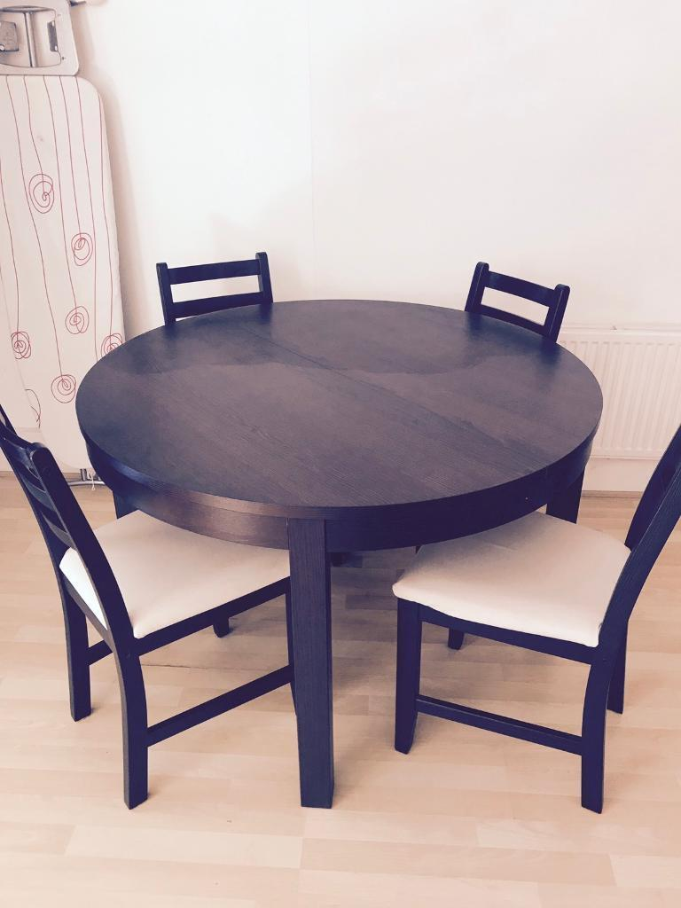 ikea bjursta round 4 seater extendable dining table only does not include chairs in high. Black Bedroom Furniture Sets. Home Design Ideas