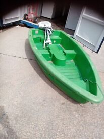 Green plastic boat with engine