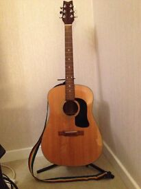 Washburn acoustic guitar with stand and strap