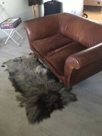 Two seater vintage leather sofa( West Sussex)