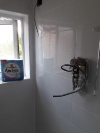 Bathroom fitter plumbing and tiling
